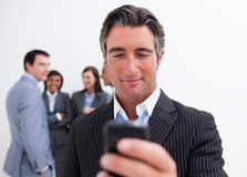 Confident manager sending a text Royalty Free Stock Photography