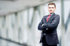 Confident manager in suit posing against. In office Royalty Free Stock Images