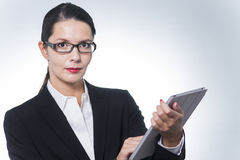Confident manageress working on a tablet Stock Image