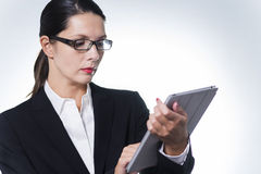Confident manageress working on a tablet Royalty Free Stock Photo