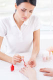 Confident manicurist at work. Royalty Free Stock Image