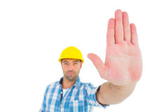 Confident manual worker gesturing stop sign. On white background Stock Photo