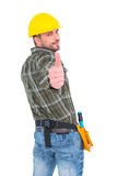 Confident manual worker gesturing thumb up Stock Photo