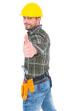 Confident manual worker gesturing thumb up. Confident manual worker gesturing thumbs up on white background stock images