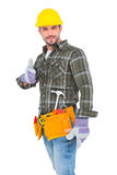 Confident manual worker gesturing thumb up. On white background stock photos