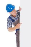 Confident manual worker holding billboard. Full length portrait of confident young manual worker holding billboard over white background stock photos