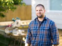 Confident Manual Worker Standing At Construction Royalty Free Stock Image