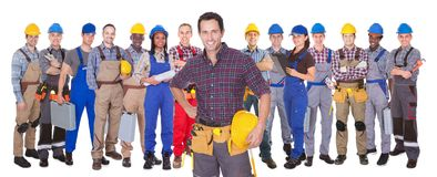 Confident manual workers against white background Stock Image