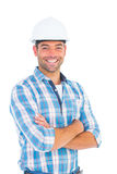 Confident manual working wearing hardhat. Portrait of confident manual working wearing hardhat on white background royalty free stock photo