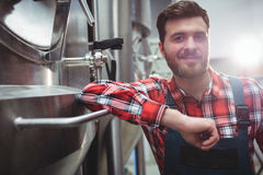 Confident manufacturer standing in brewery Royalty Free Stock Photo
