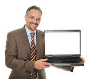 Confident marketing executive displaying a laptop Royalty Free Stock Image