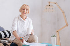 Confident mature blonde posing on camera Royalty Free Stock Photography
