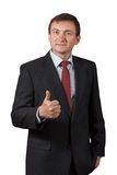 Confident mature businessman approves decision and shows thumb stock photo