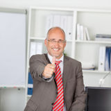 Confident Mature Businessman Gesturing Thumbs Up Royalty Free Stock Images