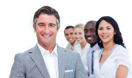 Confident mature businessman with his team Stock Images