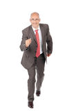 Confident Mature Businessman Running Over White Background Stock Images
