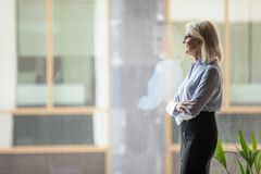 Free Confident Mature Businesswoman Pondering Strategy, Standing Near Window Stock Images - 155758114