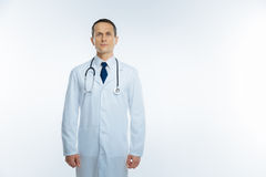 Confident mature doctor in white coat over white background Stock Photography