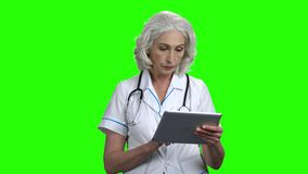 Confident mature female doctor on green screen. stock video