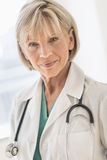 Confident Mature Female Doctor In Hospital Stock Photos