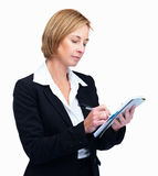Confident mature female taking notes on notepad Stock Photography