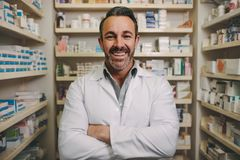 Confident mature male pharmacist royalty free stock photo