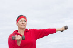 Confident Mature woman exercising outdoor Stock Photo