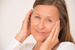 Confident mature woman happy portrait Stock Photo