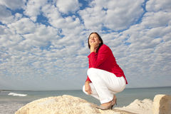 Confident mature woman ocean background Stock Photos