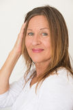 Confident mature woman posing happy Royalty Free Stock Image