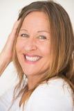 Confident mature woman posing joyful Royalty Free Stock Image