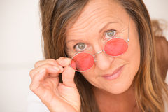 Confident mature woman red glasses Stock Image