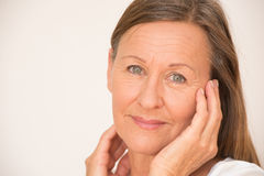 Confident mature woman relaxed portrait Stock Image