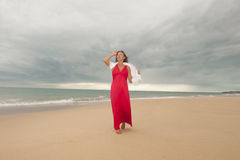 Confident Mature woman storm at beach Royalty Free Stock Photography