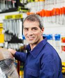 Confident Mature Worker Smiling In Hardware Shop Stock Photos