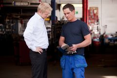 Confident Mechanic with Customer Stock Photography