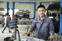 Confident Mechanic Fixing Car Engine, Looking At Camera Royalty Free Stock Image
