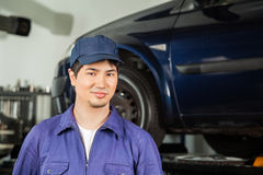 Confident Mechanic Standing At Repair Shop Royalty Free Stock Image