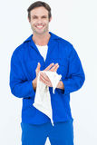 Confident mechanic wiping hand with napkin Stock Photography