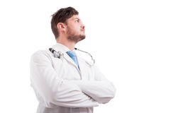 Confident medic or doctor with folded hands Stock Images