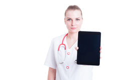 Confident medic or doctor woman showing blank screen display tab Stock Images