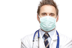 Confident medical doctor with mask and stethoscope Stock Photography