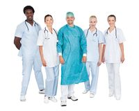 Confident medical team against white background Stock Photos