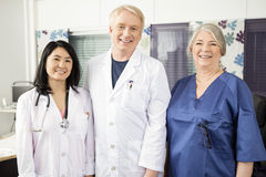 Confident Medical Team Smiling Together In Clinic. Portrait of confident medical team smiling together in clinic royalty free stock photography