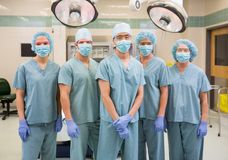 Confident Medical Team Standing In Operation Room Royalty Free Stock Images