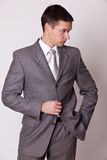 Confident men in gray suit Royalty Free Stock Image