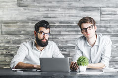 Confident men using laptop Stock Photos