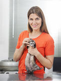 Confident Mid Adult Woman Holding Weasel Stock Images