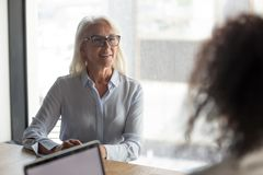 Confident middle-aged woman applicant overcome office interview