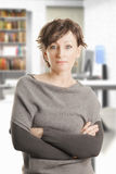 Confident middle aged woman in gray Royalty Free Stock Photography